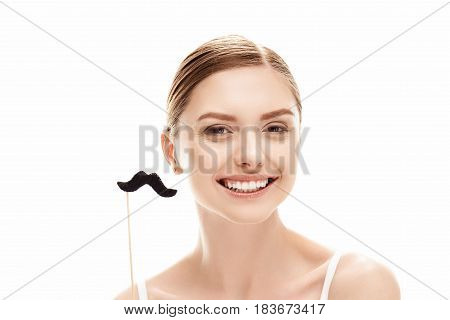 Smiling Beautiful Young Woman Holding Fake Moustache On Stick, Skin Care Concept