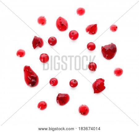 Cranberry sauce dots on white background