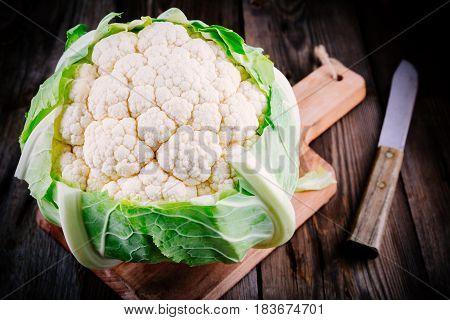 Fresh raw organic cauliflower on a wooden rustic background