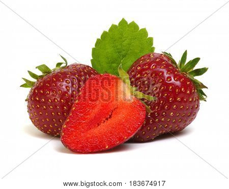 Strawberries with leaves isolated on a white background.