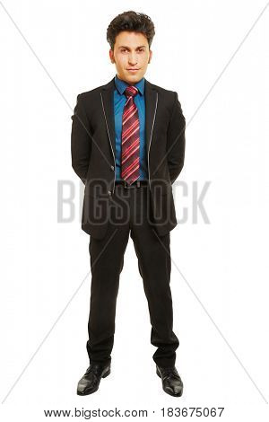 Happy businessman in front view with his arms behind his back