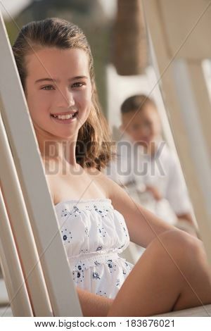 Caucasian girl sitting in chair