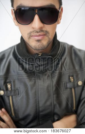 Hispanic man in sunglasses and leather coat