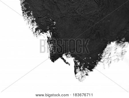 black brush strokes oil paints on white paper. Isolated on white background. Abstract creative background