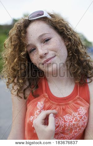 Caucasian girl wearing sunglasses