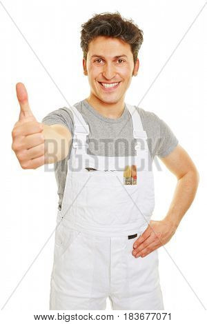 Happy painter in white overall holding thumbs up