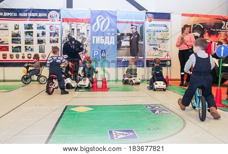 St. Petersburg Russia - 15 April, Teaching children's playground,15 April, 2017. International Motor Show IMIS-2017 in Expoforurum. Visitors and participants of the annual moto-salon in St. Petersburg.