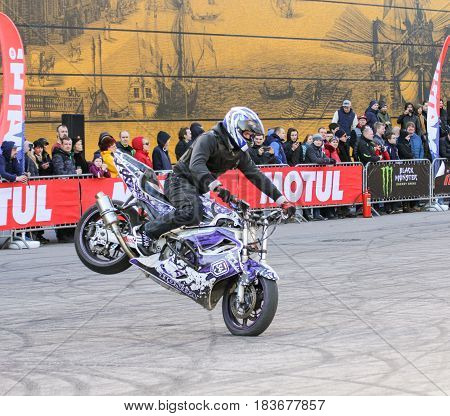 St. Petersburg Russia - 15 April, Biker on the front wheel,15 April, 2017. International Motor Show IMIS-2017 in Expoforurum. Sports motorcycle show of bikers on the open area.