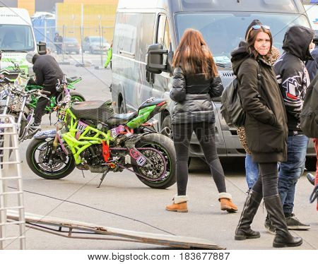 St. Petersburg Russia - 15 April, Parking of motobikes between cars,15 April, 2017. International Motor Show IMIS-2017 in Expoforurum. Sports motorcycle show of bikers on the open area.