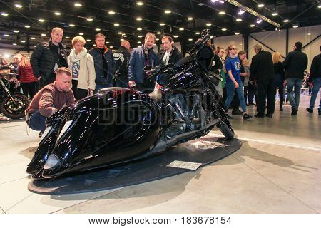 St. Petersburg Russia - 15 April, Visitors at the custom-made bike,15 April, 2017. International Motor Show IMIS-2017 in Expoforurum. Visitors and participants of the annual moto-salon in St. Petersburg.