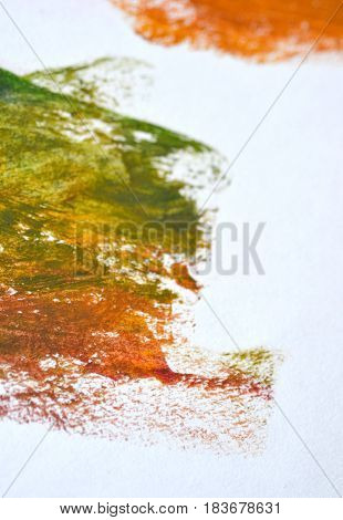 Yellow green spot Oil paint on a white background isolated smeared. Abstract creative background