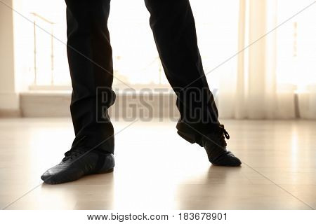 Legs of handsome young man in dance studio