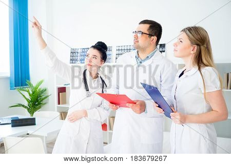 Portrait of three doctors at office in hospital