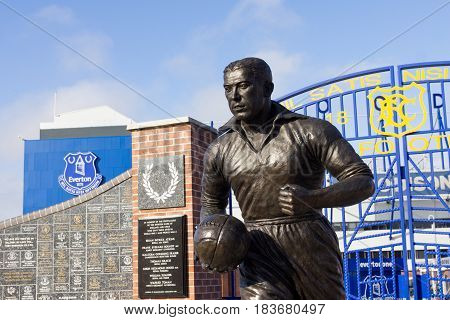 LIVERPOOL, ENGLAND - APRIL 1, 2017: View of the Everton Football Club stadium and statue of Dixie Dean. The famous goalscorer played the majority of his career at the club.