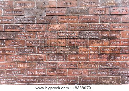 Liverpool, England - April 3, 2017: View of the Cavern Wall of Fame in front of the Cavern Pub. It features 1801 bricks engraved with names of all artists that appeared at the club from 1957 to 1973.