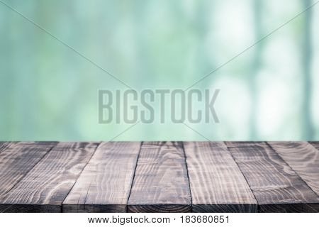 Old wood table top on blurred background,Space available for the product