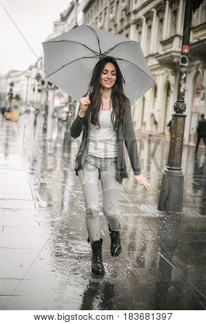 Woman Dancing In The Rain With Umbrella, Splash In Puddle
