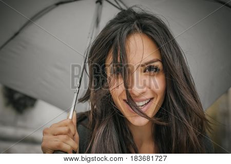 Happy Smiling Woman Under Umbrella In Rain