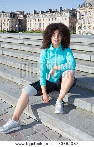 Cheerful Sport Active Woman Sitting On The City