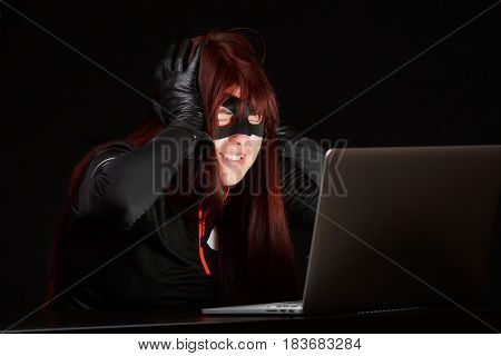 Happy hacker in black mask