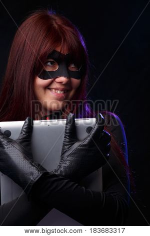 Happy thief in black gloves