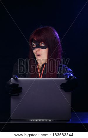 Young brunette hacker at night