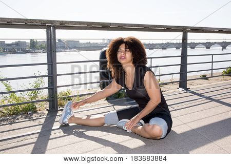 Cheerful Woman Doing Exercices In Fitness After Jogging Running