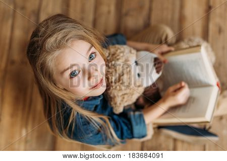 Overhead View Of Little Girl With Teddy Bear Holding Book, Education Kids Concept