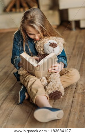 Concentrated Little Girl With Teddy Bear Reading Book, Education Kids Concept
