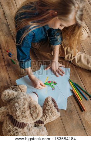 Little Girl Drawing Picture On Floor At Home, Kids Drawing Concept