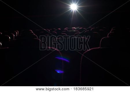 Empty cinema theater without spectators. Movie theater background. Cinema, entertainment and leisure concept.