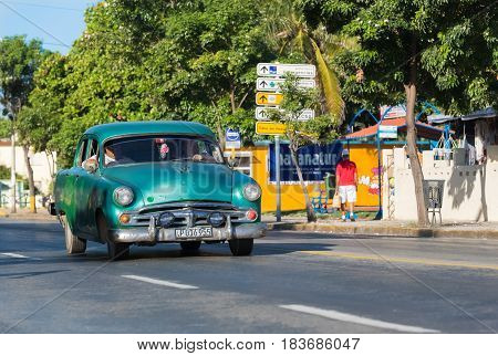 Varadero, Cuba - September 17, 2016: American classic car drived on the street through the Varadero Cuba