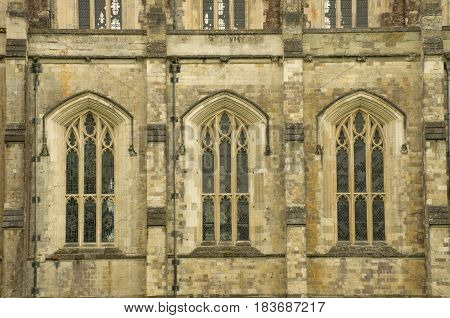 Side of Winchester Cathedral with norman windows