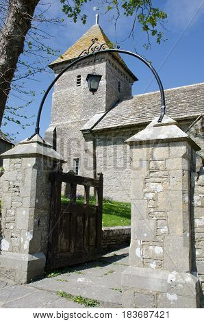 Dorset church with stone gate in foreground