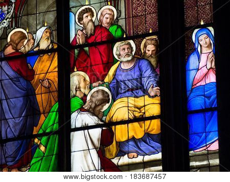 June 5 2015. A stained glass window portrays a scene from the holy bible. Cologne Cathedral Germany.
