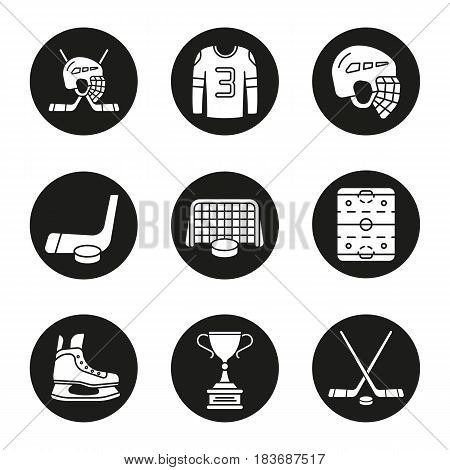 Hockey equipment icons set. Helmet, puck and sticks, shirt, gate, skate, winner's trophy, hockey rink. Vector white silhouettes illustrations in black circles