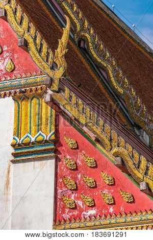 Lavishly decorated Thai building roof. Traditional Thai architecture detail art background