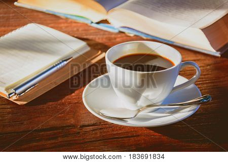 Coffee Mug And Book On Old Wooden Table