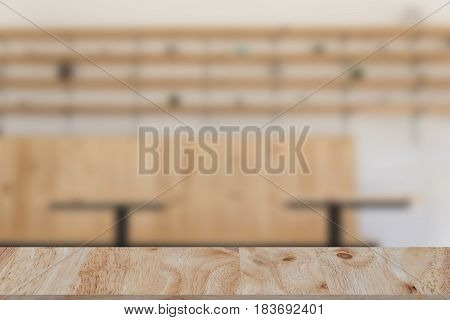 Restaurant Or Coffee Shop Blur Background With Selected Focus Wood Table For Montage Or Display Your