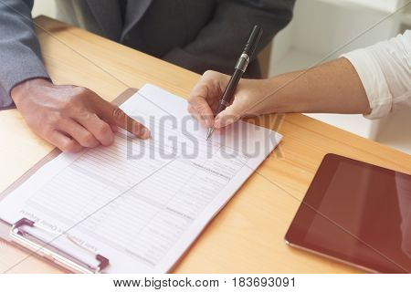 Person's Hand Hold Ballpoint Pen Writing On Blank Application Form Paper Sheet, Fill In Empty Docume