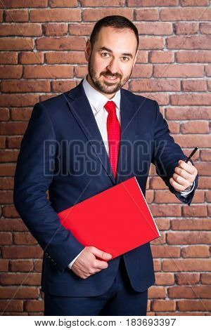 Businessman With A Red Pack Offers To Take A Pen