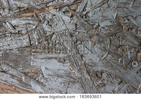 Old gray painted chipboard shot close-up for texture