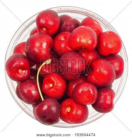 Cherry barries in a glass bowl isolated on white background