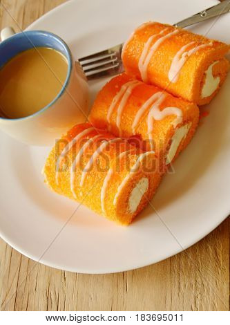 orange jam roll filled cream eat couple with coffee on dish