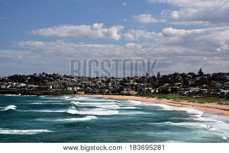 Panoramic view of Curl Curl beach on a sunny day from Dee Why Headland. A great place to relax as the beach is mainly frequented by locals.