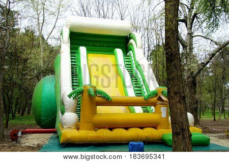 The slide in the Park. Children's inflatable slide for children. She's a big, tall, kids love it to go down. She is so elastic that it and you can jump.