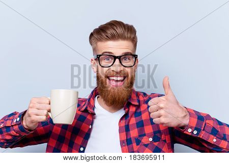 Close Up Photo Of Crazy Happy Smiling Man In Spectacles Holding Cup Of Tasty Fresh Coffee And Showin