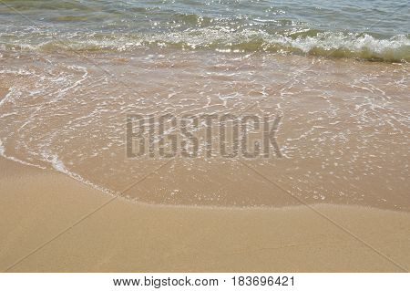 sea water throw to beach in sunny day