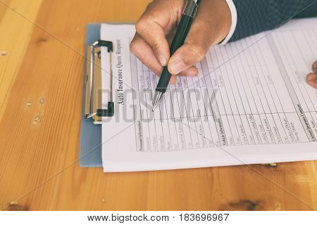 Hand Fill Out Auto Insurance Form On A Clipboard - Car Motor Reimbursement Vehicle Concept