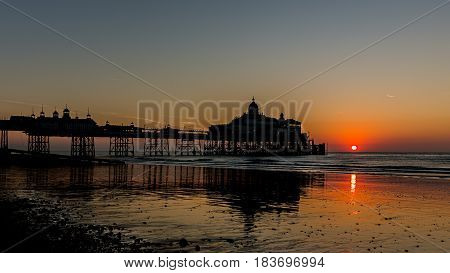 Sun rise at Brighton Pier beach England